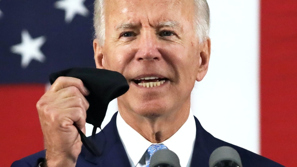 WILMINGTON, DELAWARE - JUNE 30: Democratic presidential candidate, former Vice President Joe Biden holds up a mask as he speaks during a campaign event June 30, 2020 at Alexis I. Dupont High School in Wilmington, Delaware. Biden discussed the Trump Administration's handling of the COVID-19 pandemic. (Photo by Alex Wong/Getty Images)