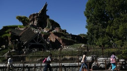 Guests walk in line to Splash Mountain at Walt Disney Co.'s Disneyland Park, part of the Disneyland Resort, in Anaheim, California, U.S., on Wednesday, Nov. 6, 2013. The Walt Disney Co. is scheduled to release earnings figures on Nov. 7. Photographer: Patrick Fallon/Bloomberg via Getty Images