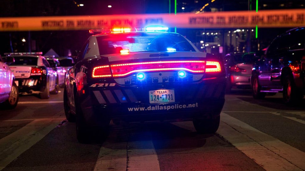 Police cars sit on Main Street in Dallas following the sniper shooting during a protest on July 7, 2016.