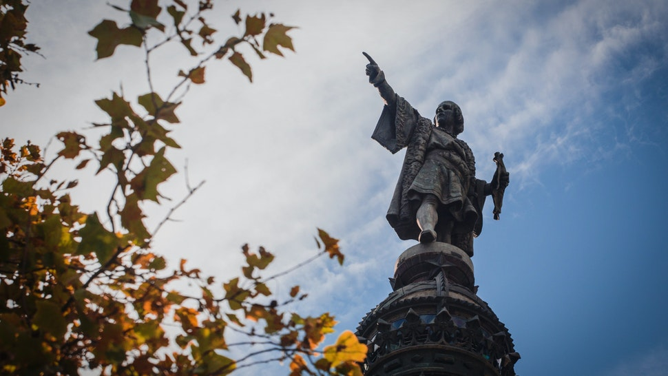 Monument Of Christopher Columbus Against Cloudy Sky - stock photo