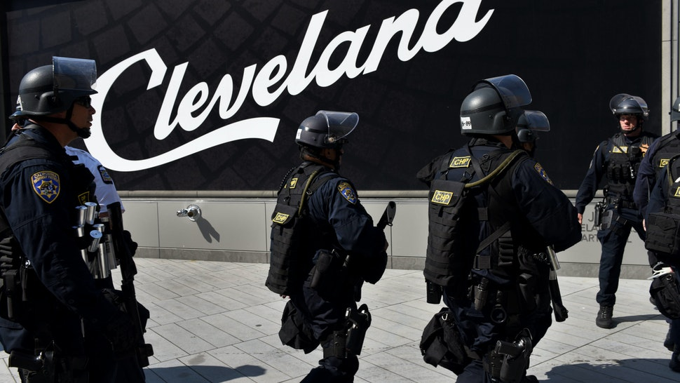 CLEVELAND, OH - JULY 19: A unit of the California Highway Patrol enter Public Square in downtown Cleveland with riot gear and tear gas rifles on July 19, 2016. Protests were largely peaceful in the square throughout the day. (Photo by Michael Robinson Chavez/The Washington Post via Getty Images)