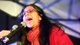 Seattle City Councilmember Kshama Sawant speaks at rally at Westlake Center on March 8, 2017 in Seattle, Washington.