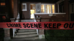 CHICAGO, IL - MAY 27: Crime scene tape is stretched around the front of a home where a man was shot on May 28, 2017 in Chicago, Illinois. Chicago police have added more than 1,000 officers to the streets over the Memorial Day weekend, hoping to put a dent in crime, during what is typically one of the more violent weekends of the year. In 2016, 6 people were killed and another 65 were wounded by gun violence over the Memorial Day weekend. (Photo by Scott Olson/Getty Images)