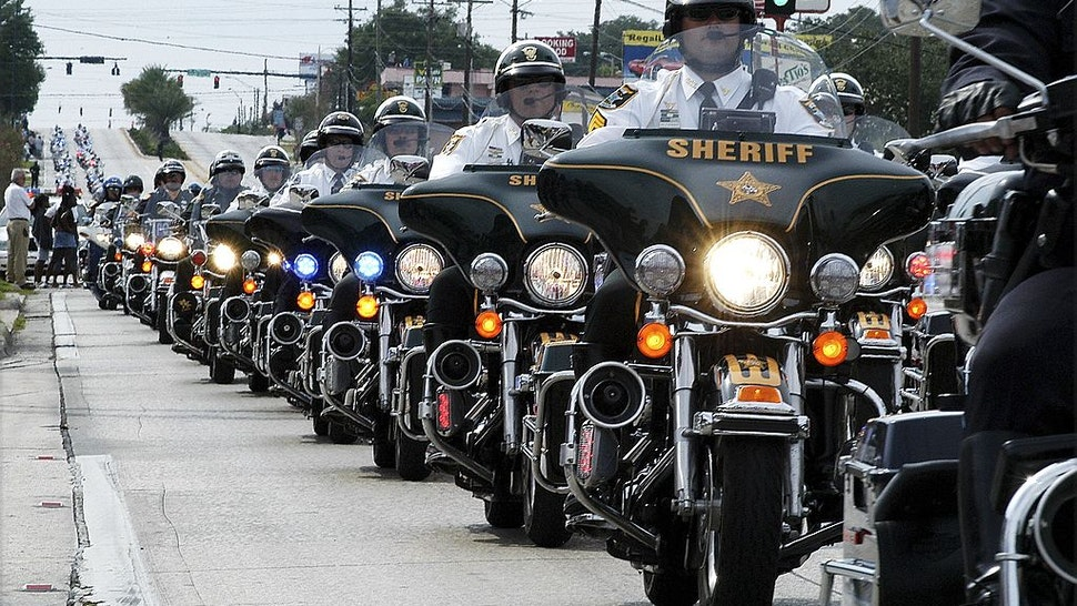 Motorcycle officers from around the country lead the procession for slain Polk County Sheriff's Deputy Matt Williams and his K9 Dioji October 3, 2006 in Lakeland, Florida.