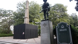 A monument to volunteers of the Army of the Republic stands next to a confederate monument covered up by the mayor of Birmingham in Linn Park August 18, 2017 in Birmingham, Alabama.
