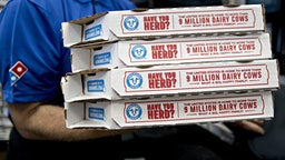 A employee moves pizza boxes before a delivery at a Domino's Pizza Inc. restaurant in Chantilly, Virginia, U.S., on Tuesday, Feb. 20, 2018. Domino's released earnings figures on February 20. Photographer: Andrew Harrer/Bloomberg via Getty Images