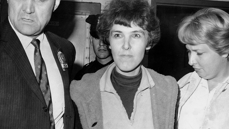 Detective Frederick Stepat and policewoman McCarthy escort Valeria Solanas, 28, into 13th pct, for the shooting of Pop Art movie man Andy Warhol at his 33 Union Square West office.