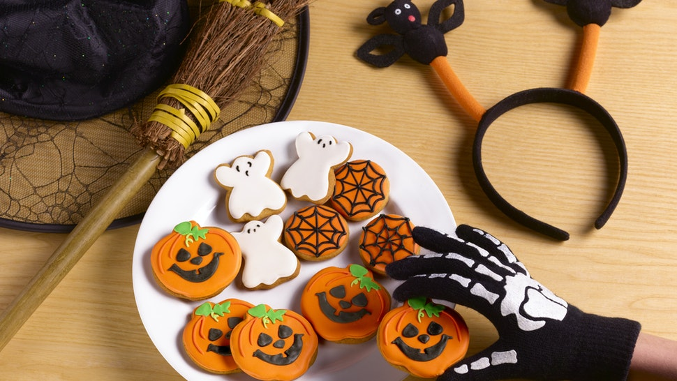 Halloween party with witches costume and cookies - stock photo