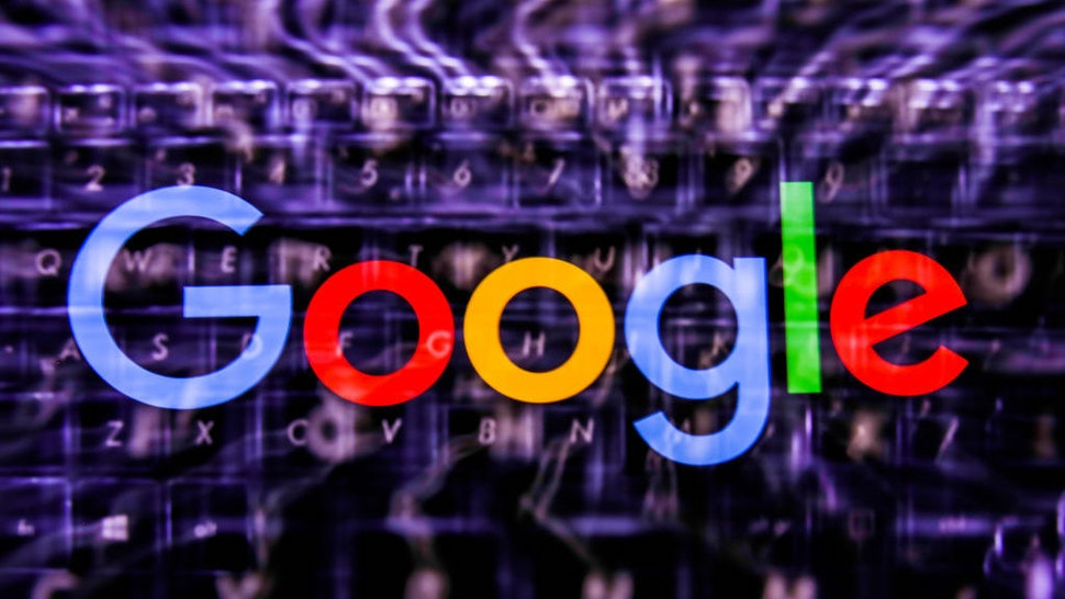 Google logo displayed on a phone screen and keyboard are seen in this multiple exposure illustration photo taken in Poland on June 14, 2020. European Commission officials said that Facebook, Twitter and Google should provide monthly fake news reports to prevent fake news about coronavirus pandemic. (Photo Illustration by Jakub Porzycki/NurPhoto via Getty Images)