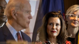 Former Vice President Joe Biden speaks as Michigan Governor Gretchen Whitmer looks on at an event at Cherry Health in Grand Rapids, MI on March 9, 2020. (Photo by Carolyn Van Houten/The Washington Post via Getty Images)