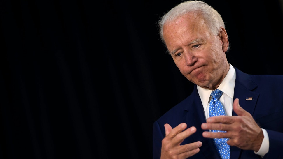 US Democratic presidential candidate Joe Biden answers questions after speaking about the coronavirus pandemic and the economy on June 30, 2020, in Wilmington, Delaware.