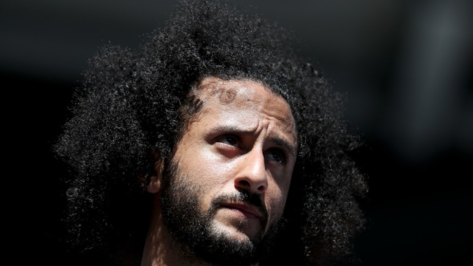 NEW YORK, NEW YORK - AUGUST 29: Former San Francisco 49er Colin Kaepernick watches a Women's Singles second round match between Naomi Osaka of Japan and Magda Linette of Poland on day four of the 2019 US Open at the USTA Billie Jean King National Tennis Center on August 29, 2019 in Queens borough of New York City.