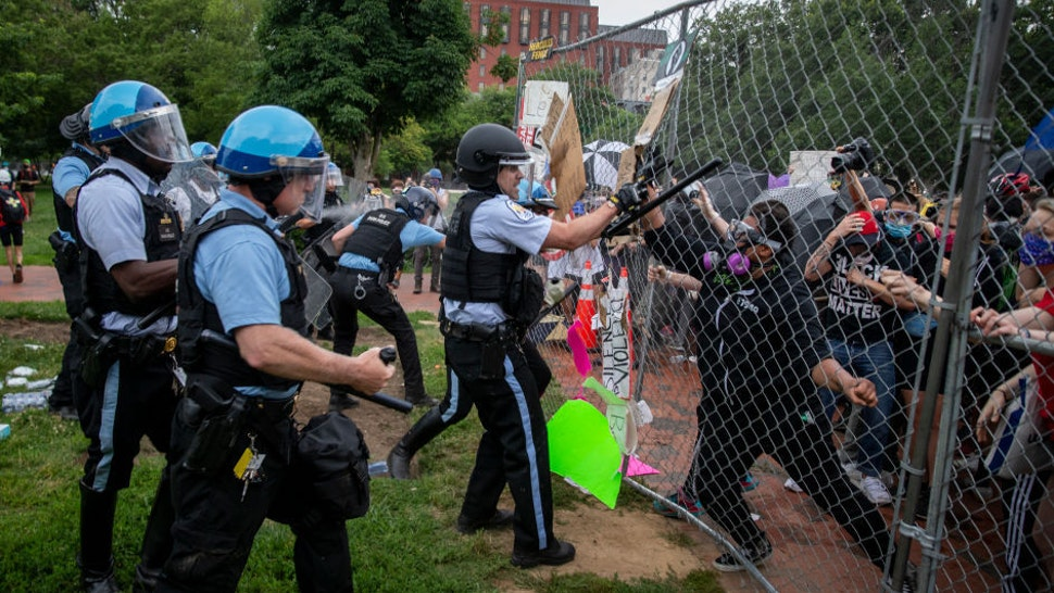 Protesters clash with U.S. Park Police after protesters attempted to pull down the statue of Andrew Jackson in Lafayette Square near the White House on June 22, 2020 in Washington, DC. Protests continue around the country over the deaths of African Americans while in police custody. (Photo by Tasos Katopodis /Getty Images)