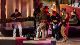 Police officers surround a person that was shot near the 300 block of South Las Vegas Boulevard, on June 1, 2020, in downtown Las Vegas, at the end of a rally in response to the recent death of George Floyd, an unarmed black man who died while in police custody. - Thousands of National Guard troops patrolled major US cities after five consecutive nights of protests over racism and police brutality that boiled over into arson and looting, sending shock waves through the country. The death Monday of an unarmed black man, George Floyd, at the hands of police in Minneapolis ignited this latest wave of outrage in the US over law enforcement's repeated use of lethal force against African Americans -- this one like others before captured on cellphone video.