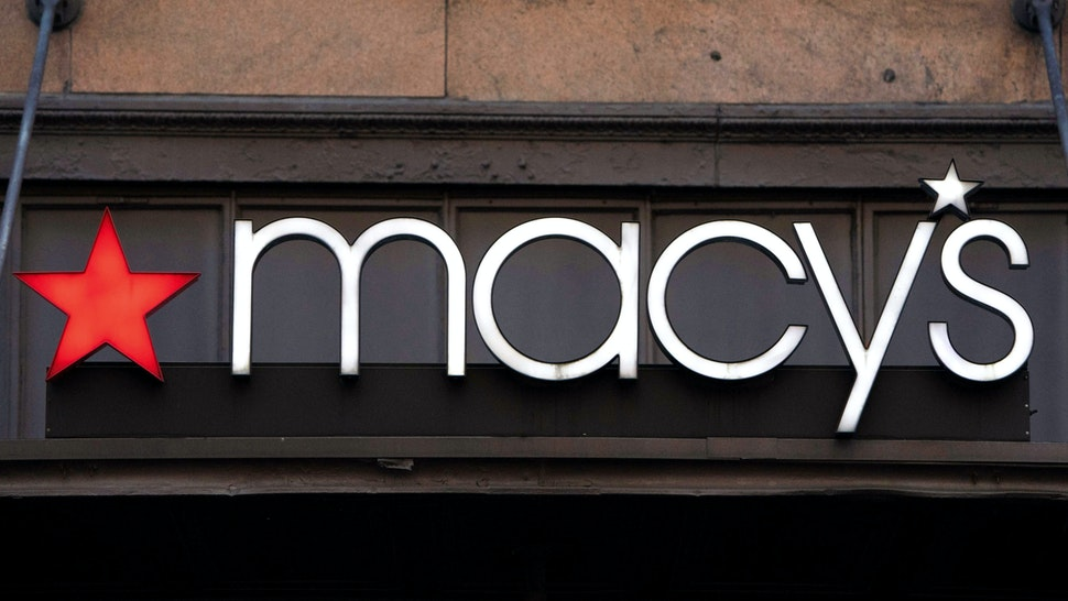 A store sign hangs on the Macy's store at Manhattan's Herald Square January 11, 2019 in New York. Macy's boasts being the world's largest store.