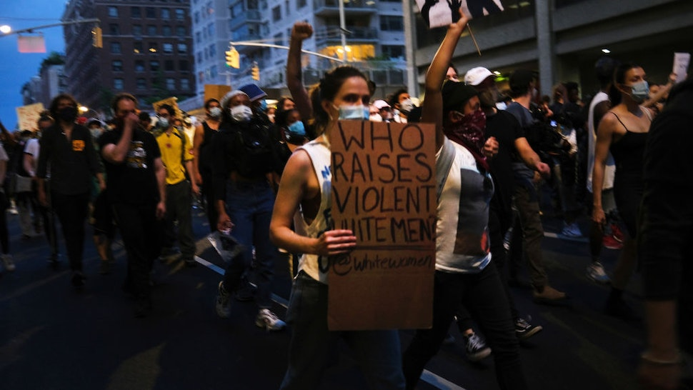 Protesters march in Manhattan over the killing of George Floyd by a Minneapolis Police officer on June 03, 2020 in New York City. The white police officer, Derek Chauvin, has been charged with second-degree murder and the three other officers who participated in the arrest have been charged with aiding and abetting second-degree murder. Floyd's death, the most recent in a series of deaths of black Americans at the hands of police, has set off days and nights of protests across the country. (Photo by Spencer Platt/Getty Images)