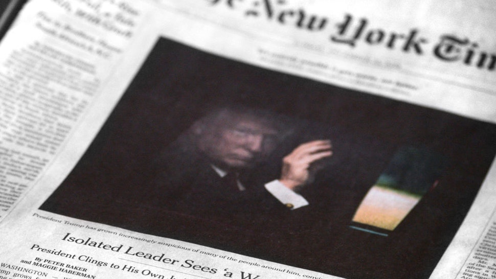 A copy of the December 23, 2018 edition of The New York Times features a front-page article by Peter Baker and Maggie Haberman referring to U.S. President Donald Trump as an isolated leader who sees 'a war every day.' (Photo by Robert Alexander/Getty Images)