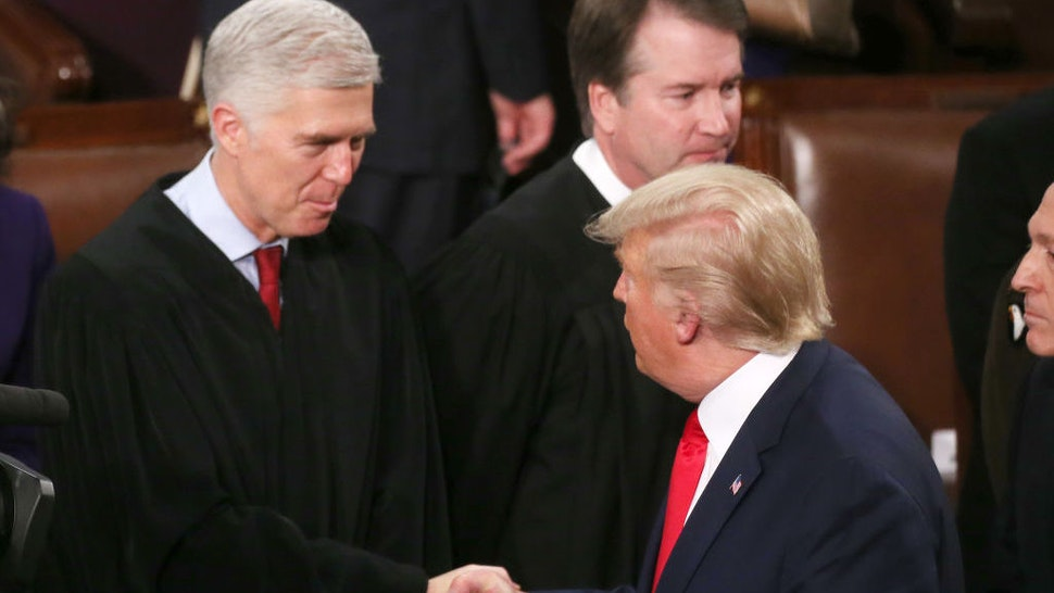 WASHINGTON, DC - FEBRUARY 04: U.S. President Donald Trump greets Supreme Court Justice Neil Gorsuch ahead of the State of the Union address in the chamber of the U.S. House of Representatives on February 04, 2020 in Washington, DC. President Trump delivers his third State of the Union to the nation the night before the U.S. Senate is set to vote in his impeachment trial. (Photo by Mario Tama/Getty Images)