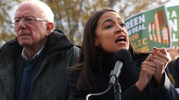 Democratic presidential candidate Sen. Bernie Sanders (I-VT) (L) and Rep. Alexandria Ocasio-Cortez (D-NY) hold a news conference to introduce legislation to transform public housing as part of their Green New Deal proposal outside the U.S. Capitol November 14, 2019 in Washington, DC. The liberal legislators invited affordable housing advocates and climate change activists to join them for the announcement. (Photo by Chip Somodevilla/Getty Images)