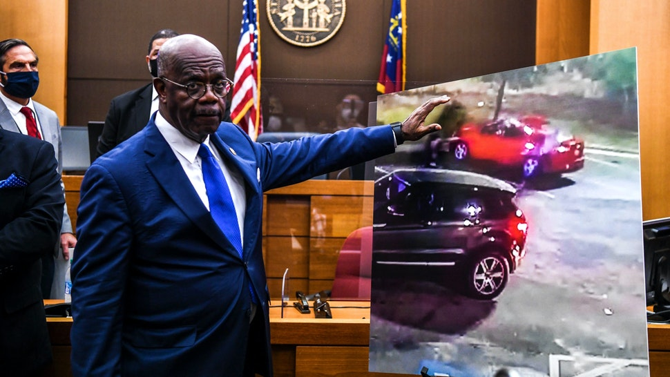 Fulton County District Attorney Paul L. Howard Jr. point at a picture displayed inside the courtroom as he announces 11 charges against former Atlanta Police Officer Garrett Rolfe on June 17, 2020, in Atlanta, Georgia. - An Atlanta police officer will be charged with murder for shooting a 27-year-old man in the back, justice officials announced June 17 in the latest case to spark anger over police killings of African Americans.