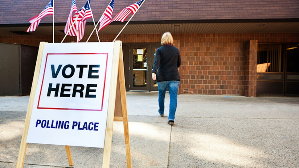 Woman entering polling place.