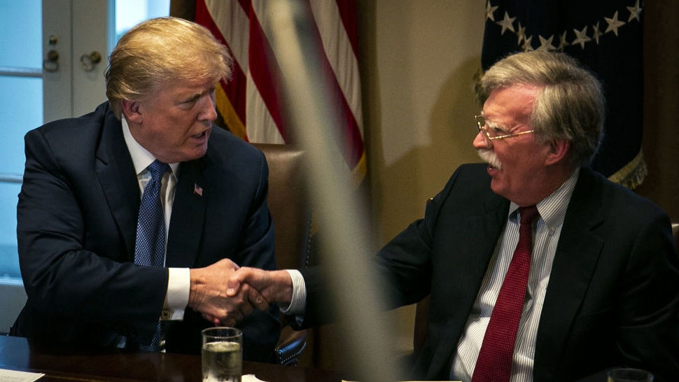 U.S. President Donald Trump, left, shakes hands with John Bolton, national security advisor, during a meeting with senior military leadership in the Cabinet Room of the White House in Washington, D.C., U.S., on Monday, April 9, 2018. Trump said he'll decide within two days on U.S. retaliation against Syria for a suspected chemical weapons attack by President Bashar al-Assad's regime over the weekend, and suggested Russian President Vladimir Putin may share responsibility. Photographer: Al Drago/Bloomberg
