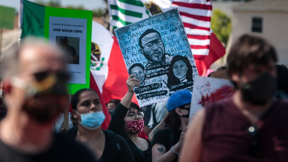 Hundreds of people rallied and marched to the Compton Sheriffs' Office in protest for the shooting of Andres Guardado, security guard who was fatally shot by a Los Angeles County sheriff's deputy on Sunday, June 21, 2020 in Gardena, California. (Jason Armond / Los Angeles Times via Getty Images)
