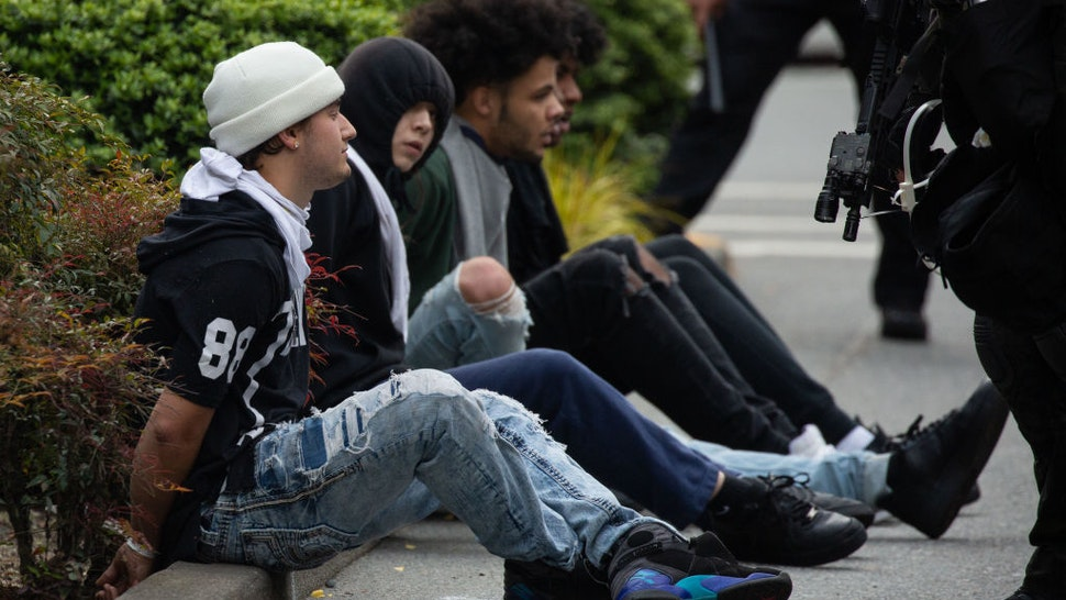 BELLEVUE, WA - MAY 31: Police detain people near Bellevue Square Mall on May 31, 2020 in Bellevue, Washington. Protests due to the recent death of George Floyd took place in Bellevue in addition to Seattle, with looting in Bellevue and at least one burned automobile there. (Photo by David Ryder/Getty Images)