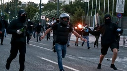 Protesters hurl petrol bombs to riot police officers during a demonstration at the U.S. embassy over the death of George Floyd , in Athens, Greece on June 3, 2020. (Photo by Panayotis Tzamaros/NurPhoto)