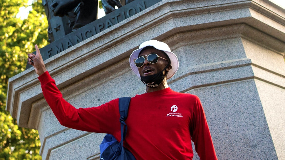 A protest leader speaks during a rally in support for the removal of the Emancipation Statue at Lincoln Park in Washington, DC on June 23, 2020. - As the wave of anti-racism protests rocking the United States brings down monuments to figures linked to the country's history of slavery, the spotlight is shifting to other prominent people long considered untouchable.