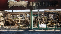The charred wreckage of an Auto Parts store destroyed during last week's rioting which was sparked by the death of George Floyd on June 3, 2020 in Minneapolis, Minnesota. - Former Minneapolis police officer Derek Chauvin, who kneeled on the neck of George Floyd who later died, will now be charged with second-degree murder, and his three colleagues will face charges of aiding and abetting second-degree murder, court documents revealed on June 3. (Photo by Kerem Yucel / AFP) (Photo by KEREM YUCEL/AFP via Getty Images)