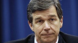 North Carolina Attorney General Roy Cooper, a Democrat, has condemned his state's Republican-sponsored voter ID law and constitutional amendment to ban same-sex marriage. But in his position he must defend the state against lawsuits on both issues. (Raleigh News & Observer/Tribune News Service via Getty Images)