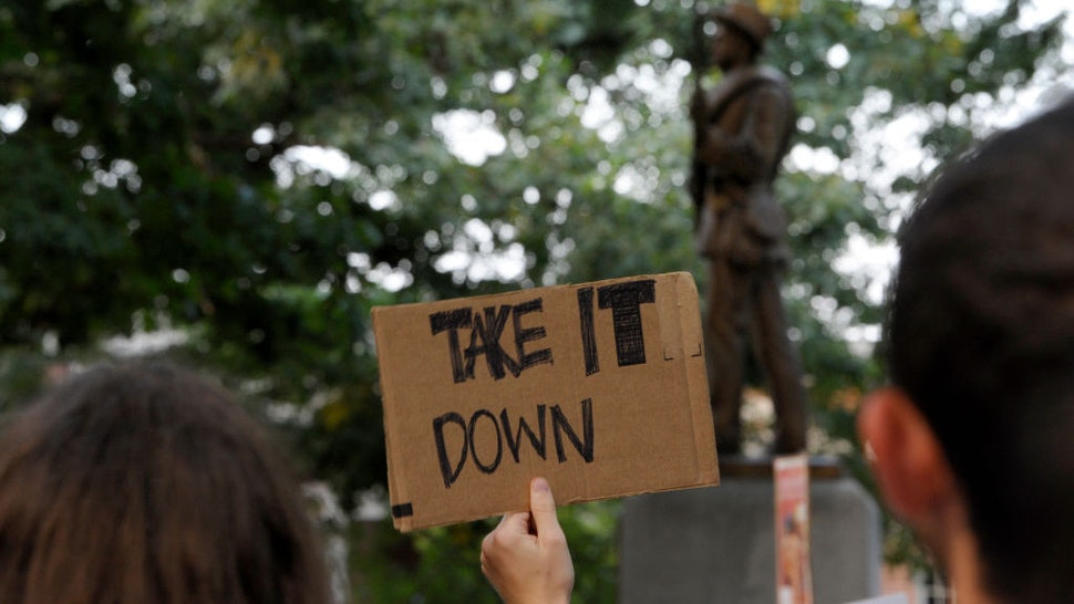Demonstrators rally for the removal of a Confederate statue coined Silent Sam on the campus of the University of Chapel Hill on August 22, 2017 in Chapel Hill North Carolina. (Photo by Sara D. Davis/Getty Images)