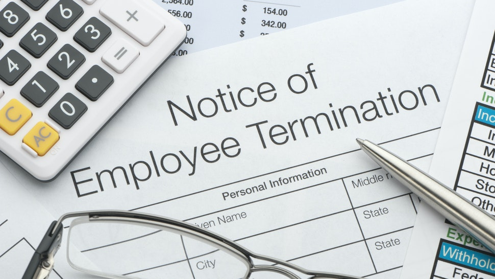 Close up of Employee termination form with pen and calculator