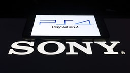 ANKARA, TURKEY - FEBRUARY 27: In this photo illustration a mobile phone and a computer screen display the PlayStation4 and Sony logo in Ankara Turkey on February 27, 2020.