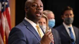 WASHINGTON, DC - JUNE 17: Sen. Tim Scott (R-SC) is joined by fellow Republican lawmakers for a news conference to unveil the GOP's legislation to address racial disparities in law enforcement at the U.S. Capitol June 17, 2020 in Washington, DC. Scott, the Senate's lone black Republican, lead the effort to write the Just and Unifying Solutions to Invigorate Communities Everywhere (JUSTICE) Act, which discourages the use of chokeholds, requires police departments to release more information on use of force and no-knock warrants, and encourages body cameras and better training.