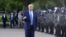 U.S. President Donald Trump returns to the White House after posing with a bible outside St. John's Episcopal Church in Washington, D.C., U.S., on Monday, June 1, 2020. Trump promised a forceful response to violent protests across the country before leaving the White House to visit a church across the street that had been been damaged by fires.