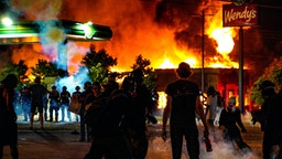 ATLANTA, USA - JANUARY 14: Demonstrators set on fire a restaurant during the protest after an Atlanta police officer shot and killed Rayshard Brooks, 27, at a Wendy's fast food restaurant drive-thru Friday night in Atlanta, United States on January 14, 2020. As nationwide protests slowed in the death of George Floyd, anger again erupted Saturday in the US over the fatal shooting of another black man. Mayor Keisha Lance Bottoms announced Atlanta Police Chief Ericka Shields voluntarily stepped down from the department earlier in the day.