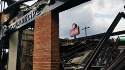 A burned Wendys restaurant is seen on the second day following the police shooting death of Rayshard Brooks in the restaurant parking lot June 14, 2020, in Atlanta, Georgia. - The fatal shooting of a black man by a white police officer, this time in Atlanta, Georgia, poured more fuel June 14, 2020 on a raging US debate over racism after another round of street protests and the resignation of the city's police chief. A Wendy's restaurant where 27-year-old Rayshard Brooks was killed was set on fire June 13, 2020 and hundreds of people marched to protest the killing. (Photo by Elijah Nouvelage / AFP) (Photo by ELIJAH NOUVELAGE/AFP via Getty Images)