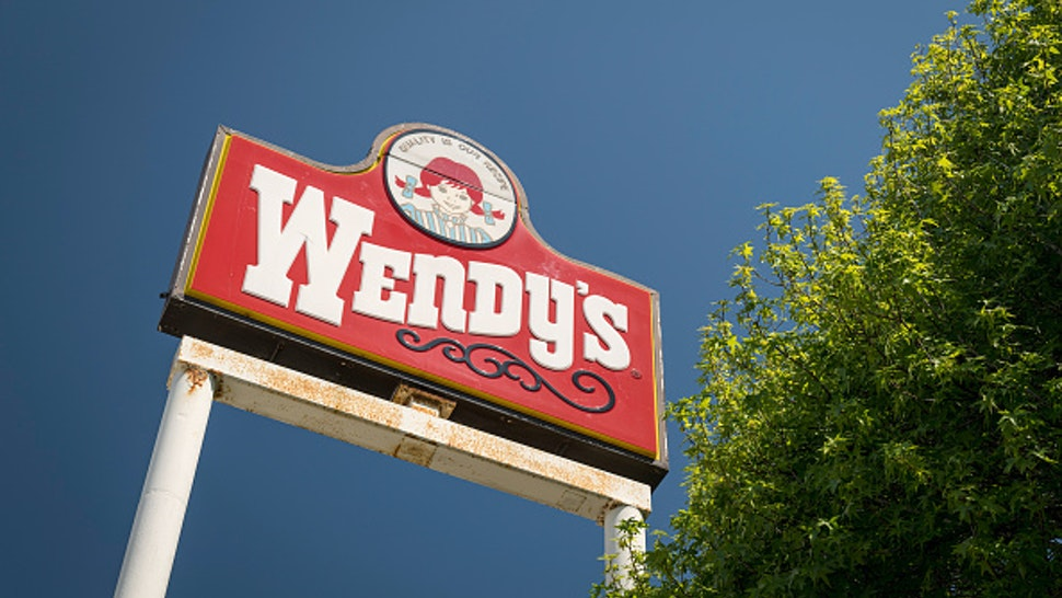 Signage is displayed at a Wendys Co. restaurant in Richmond, California, U.S., on Wednesday, May 6, 2020. Fast-food chain Wendys Co. jumped the most in a month after reporting that the sales slump caused by the Covid-19 pandemic is easing.
