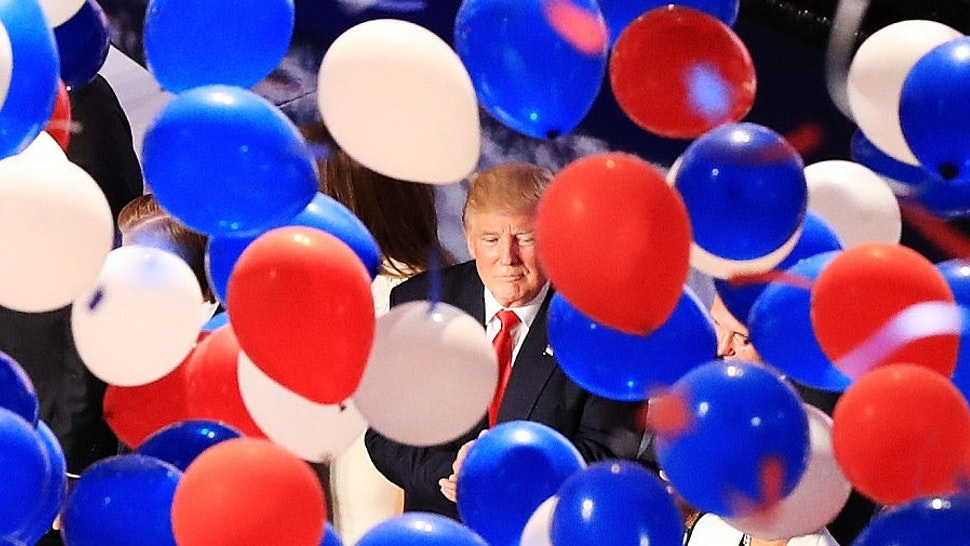 CLEVELAND, OH - JULY 21: Republican presidential candidate Donald Trump and his family acknowledge the crowd as balloons fall on the fourth day of the Republican National Convention on July 21, 2016 at the Quicken Loans Arena in Cleveland, Ohio. Republican presidential candidate Donald Trump received the number of votes needed to secure the party's nomination. An estimated 50,000 people are expected in Cleveland, including hundreds of protesters and members of the media. The four-day Republican National Convention kicked off on July 18. (Photo by