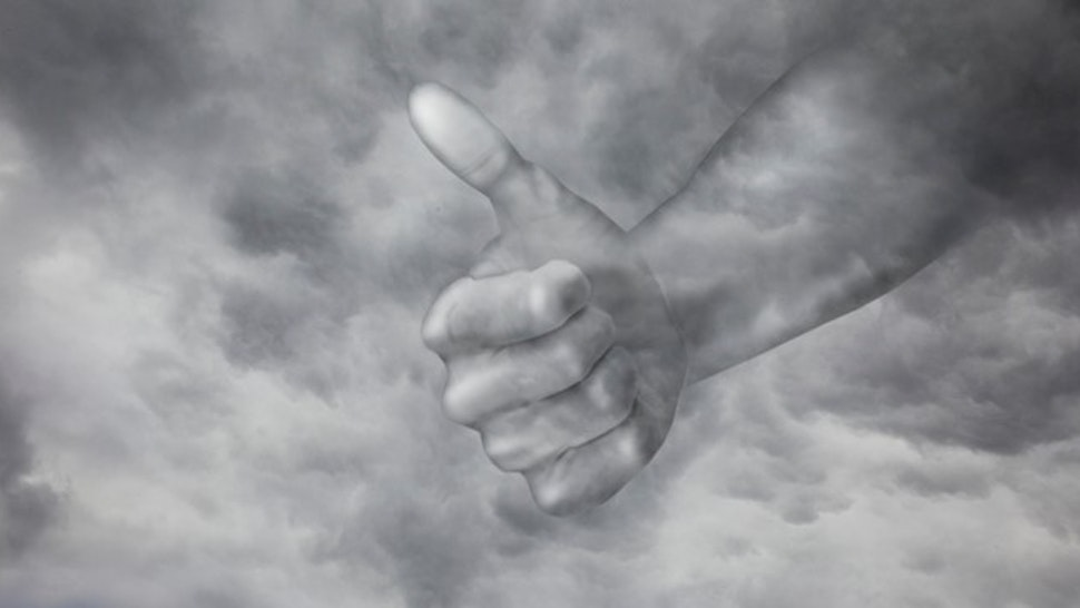 Hand from sky giving thumbs up