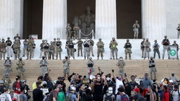 WASHINGTON, DC - JUNE 02: Members of the D.C. National Guard stand on the steps of the Lincoln Memorial monitoring demonstrators during a peaceful protest against police brutality and the death of George Floyd, on June 2, 2020 in Washington, DC. Protests continue to be held in cities throughout the country over the death of George Floyd, a black man who was killed in police custody in Minneapolis on May 25. (Photo by