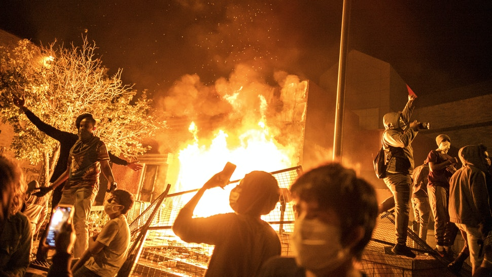 Minneapolis, MN May 28: The Minneapolis 3rd Police Precinct was set on fire by protesters after being evacuated on Thursday night.