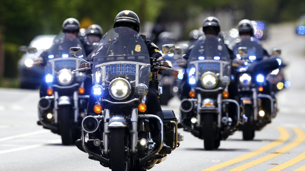 ATLANTA, GA - APRIL 4: The casket of The Rev. Joseph E. Lowery departs Cascade United Methodist church behind a police motorcade by horse and carriage, April 4, 2020, in Atlanta. For more than four decades after the death of his friend and civil rights icon, the Rev. Martin Luther King Jr., the fiery Alabama preacher was on the front line of the battle for equality, with an unforgettable delivery that rivaled Kings and was often more unpredictable.