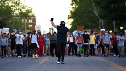 UNIVERSITY CITY, MO - JUNE 12: Protesters take to the street to protest against police brutality on June 12, 2020 in University City, Missouri. Protest continue across the world since George Floyd died in Minneapolis police custody on May 25.