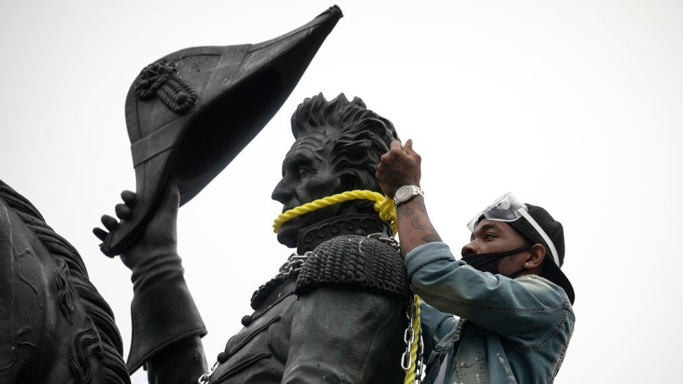 WASHINGTON, DC - JUNE 22: Protesters attempt to pull down the statue of Andrew Jackson in Lafayette Square near the White House on June 22, 2020 in Washington, DC. Protests continue around the country over the deaths of African Americans while in police custody. (Photo by