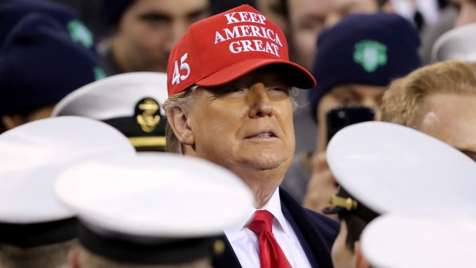 PHILADELPHIA, PENNSYLVANIA - DECEMBER 14: U.S. President Donald Trump stands with the Navy side of the field to start the second half of the game between the Army Black Knights and the Navy Midshipmen at Lincoln Financial Field on December 14, 2019 in Philadelphia, Pennsylvania. (Photo by