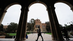 A student walks near Royce Hall on the campus of UCLA on April 23, 2012 in Los Angeles, California. According to reports, half of recent college graduates with bachelor's degrees are finding themselves underemployed or jobless. (Photo by