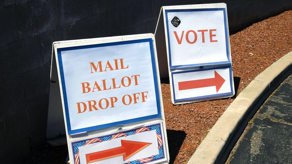 NORTH LAS VEGAS, NEVADA - JUNE 09: Signs direct people to the entrance of the Clark County Election Department, which is serving as both a primary election ballot drop-off point and an in-person voting center amid the coronavirus pandemic on June 9, 2020 in North Las Vegas, Nevada. This is the first time ballots have been mailed to all registered active voters in Nevada's history as the state holds its first-ever election done almost entirely by mail due to the risk of spreading COVID-19. The Clark County registrar said unofficial results of the election will be reported tonight but, final results will not be available until after the last ballots are counted on June 16 or 17.